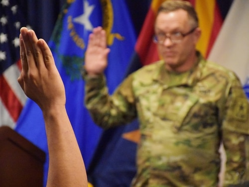A future soldier is sworn in. The Army is tightening waiver authority for serious issues like mental health and drug abuse. (Alun Thomas/Army)