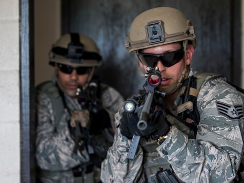 Staff Sgt. Kevin Gonzalez and Tech. Sgt. Melvin Santos, 6th Security Forces Squadron, breach a door during training at MacDill Air Force Base in Tampa, Fla., Aug. 22. The Air Force is planning big changes for the enlisted promotion system. (SrA Adam Shanks/Air Force)