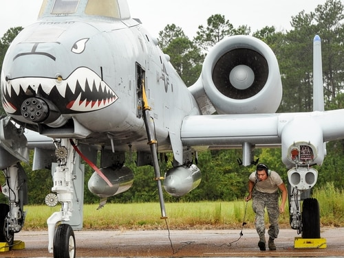 Airman Akila Shrefler, A-10 Thunderbolt II crew chief with the 23rd Aircraft Maintenance Squadron at Moody Air Force Base, Georgia, prepares an A-10 Sept. 13, 2017, for departure from Columbus AFB, Mississippi. (U.S. Air Force photo by Staff Sgt. Christopher Gross)