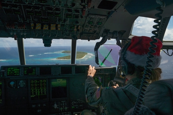 U.S. Air Force Capt. Cerre Dolby, C-130J Super Hercules aircraft commander, pilots her aircraft during a low-cost, low-altitude airdrop during Operation Christmas Drop on Dec. 15, 2017, above the Murilo Atoll. (Staff Sgt. Alexander W. Riedel/U.S. Air Force)