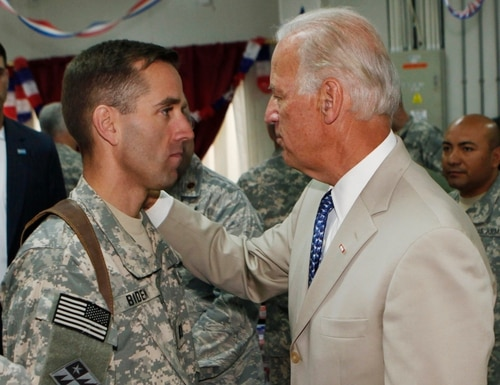 In this July 4, 2009, file photo, then-Vice President Joe Biden, right, talks with his son, Army Capt. Joseph R.