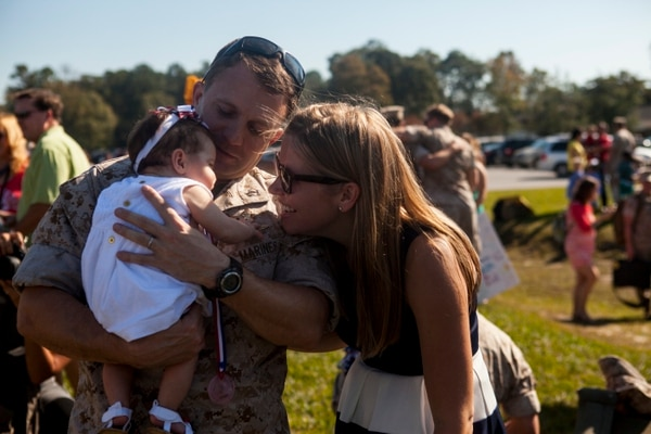 Capt. Alex Usztics, platoon commander, Force Recon, 22nd Marine Expeditionary Unit (MEU), a native of Dauphin, Pa., holds his daughter, Everly, aboard Marine Corps Base Camp Lejeune, N.C., Oct. 28, 2014. Service members with the 22nd MEU returned on MV-22B Ospreys after a nine-month deployment. (U.S. Marine Corps photograph by Lance Cpl. Christopher A. Mendoza/Released)