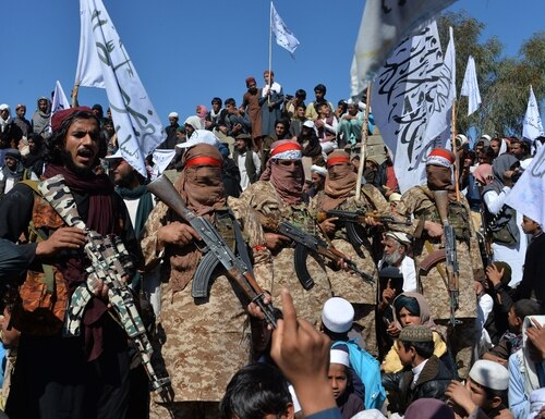 Afghan Taliban militants and villagers attend a gathering as they celebrate the peace deal in Afghanistan's Alingar district of Laghman Province on March 2, 2020. (Noorullah Shirzada/AFP via Getty Images)