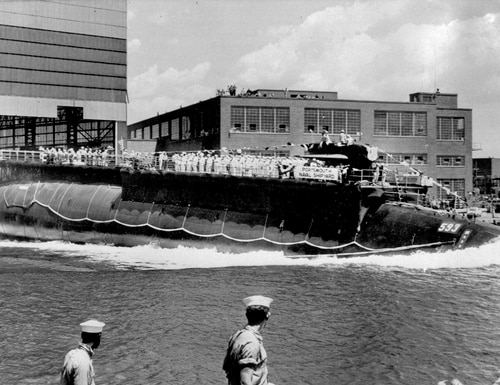 In this July 9, 1960, file photo, the U.S. Navy nuclear powered attack submarine USS Thresher is launched bow-first at the Portsmouth Navy Yard in Kittery, Maine. (AP Photo)