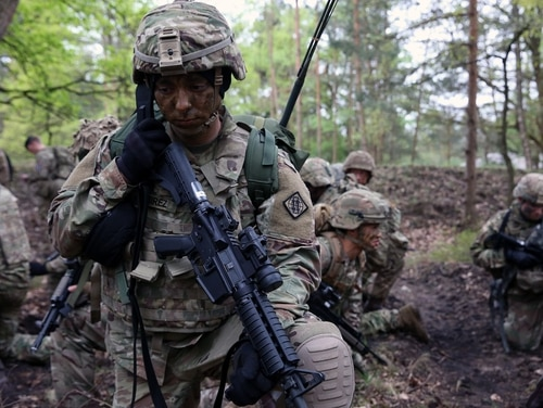 U.S. Army Cpl. Andrew Ramirez, assigned to Bravo Company, 44th Expeditionary Signal Battalion, 2nd Theater Signal Brigade, talks on a radio during during exercise Stoney Run, April 24, 2018 in the Sennelager Training Area, Germany. Stoney Run is an annual U.S.-U.K. signal exercise designed to test and validate communications and network capabilities, and enhance interoperability and partner capacity between the two NATO allies. (William B. King/U.S. Army)