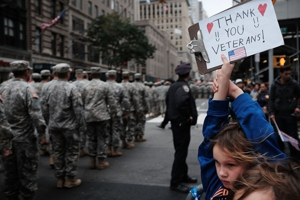 NEW YORK, NY - NOVEMBER 11: Gavin Kinney (9) holds up a sign thanking veterans at the nation's largest Veterans Day Parade in New York City on November 11, 2015 in New York City. Known as