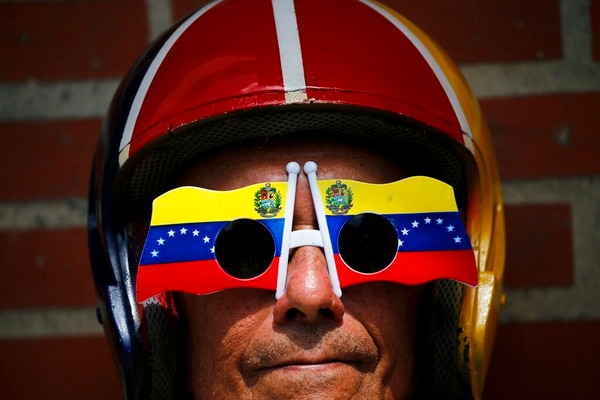 An anti-government protester wears Venezuelan flag motif sunglasses during a demonstration demanding the resignation of President Nicolas Maduro, in Caracas, Venezuela, on Saturday. (Fernando Llano/AP)