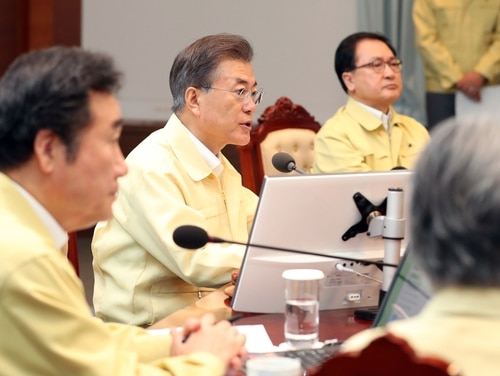 South Korean President Moon Jae-in, center, presides over a cabinet meeting at the presidential Blue House in Seoul, South Korea, Monday, Aug. 21, 2017. (Kim Ju-hyung/Yonhap via AP)