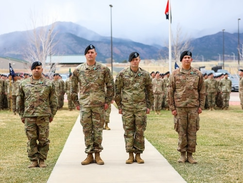 The four soldiers stand in front of their leaders and peers on April 12, 2019, during an awards ceremony at Fort Carson, Colorado. (Staff Sgt. Neysa Canfield/Army)