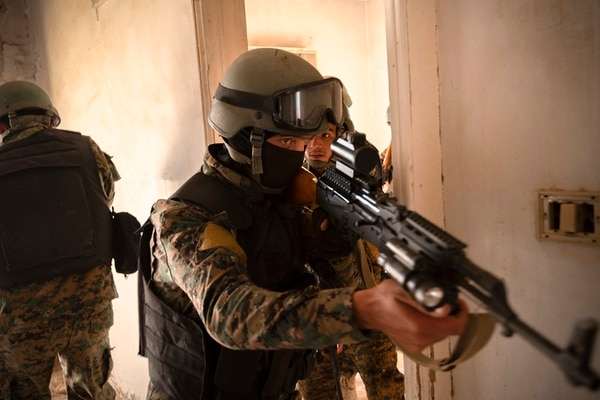 Syrian Democratic Force commando cadets clear a room during military operations in urban terrain training in Syria, Aug. 3, 2019. (Spc. Alec Dionne/U.S. Army)