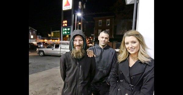 In this Nov. 17, 2017, file photo, Johnny Bobbitt Jr., left, Kate McClure, right, and McClure's boyfriend Mark D'Amico pose at a Citgo station in Philadelphia. (Elizabeth Robertson/The Philadelphia Inquirer via AP)