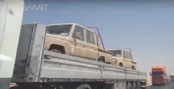 In this screen shot Toyota land cruisers are being shipped to Syrian Democratic forces in Raqqa. The footage was captured by the SMART News Agency and uploaded on August 18, 2017