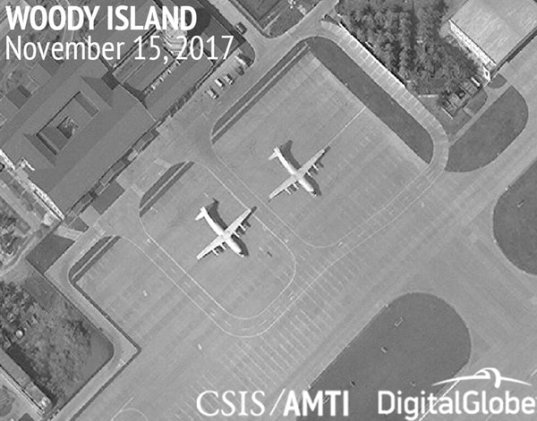 This image provided by CSIS Asia Maritime Transparency Initiative/DigitalGlobe shows a satellite image of Woody Island in the Paracel island chain in the South China Sea taken Nov. 15, 2017, and annotated by the source, showing two Chinese Y-8 military transport aircraft. (CSIS Asia Maritime Transparency Initiative/DigitalGlobe via AP)