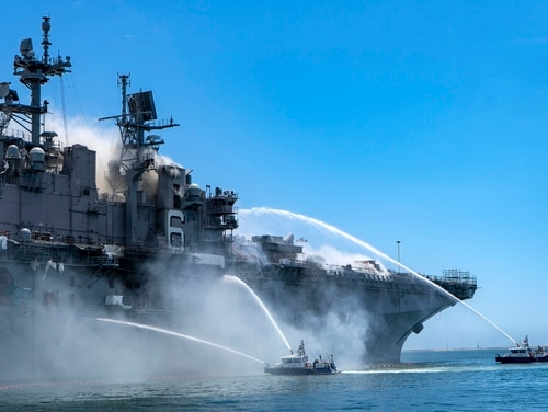 Port of San Diego Harbor Police Department boats combat a fire on board the amphibious assault ship Bonhomme Richard at Naval Base San Diego, The potential loss of Bonhomme Richard will significantly impact the Navy's deployment schedule and ability to field F-35B in the Pacific. (U.S. Navy photo by MC3 Christina Ross)
