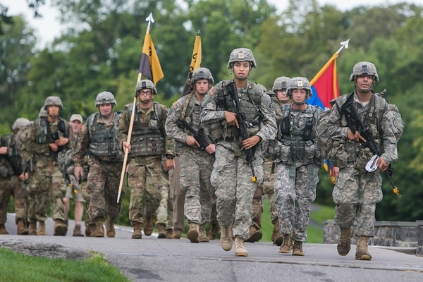 First Captain Simone Askew leads the U.S. Military Academy Class of 2021 as they complete their 12-mile March Back from Camp Buckner to West Point on Aug. 14, 2017. In addition to the Class of 2021 new cadets, USMA leadership, cadet cadre, staff, faculty and West Point alumni marched back as well. (Michelle Eberhart/Army)
