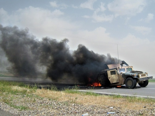 A U.S. military vehicle burns near Samarra, 95 kilometers (60 miles) north of Baghdad, Iraq, Wednesday, April 18, 2007. A roadside bomb went off next to an American military convoy, damaging one Humvee, local police said. Eyewitnesses reported casualties among U.S. troops.(AP Photo)