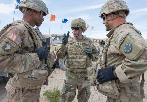 Sergeant Major of the Army Dan Dailey, center, talks to soldiers as he observes an exercise at the National Training Center at Fort Irwin, Calif., in June. The Army is working to make sure every soldier in uniform today is able to deploy if needed. (Sean Kimmons/Army)