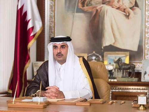 In this July 21, 2017, file photo, Emir of Qatar Sheikh Tamim bin Hamad Al Thani talks in his first televised speech since the dispute between Qatar and three Gulf countries and Egypt, in Doha, Qatar. (Qatar News Agency via AP, File)