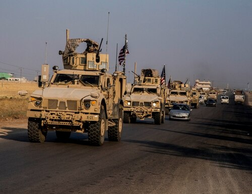 U.S. military convoy drives near the town of Qamishli, north Syria, Saturday, Oct. 26. 2019. (Baderkhan Ahmad/AP)
