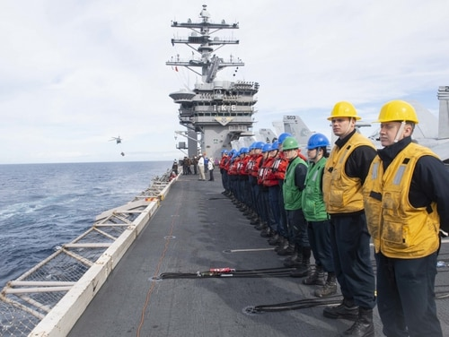 Sailors await orders during a replenishment-at-sea on board the aircraft carrier Dwight D. Eisenhower on Feb. 18. The Navy announced two days later that Ike had left for deployment immediately after completing its predeployment certification. (Mass Communication Specialist 3rd Class Isaac Champlain/Navy)