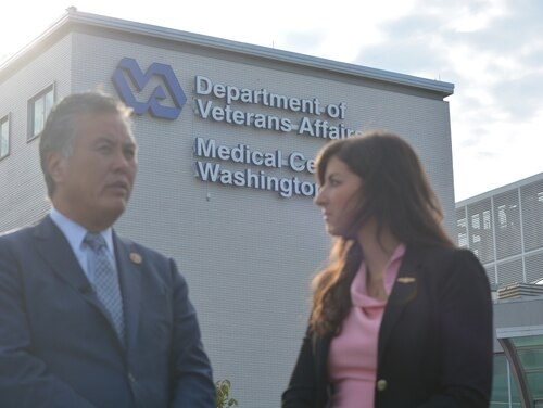 Andrea Goldstein (right), lead staffer on the House Veterans' Affairs Committee's Women Veterans Task Force, speaks with committee Chairman Rep. Mark Takano, D-Calif., (left) ahead of a press conference the Washington DC VA Medical Center on Sept. 26. Goldstein says she was sexually assaulted at the facility a week earlier. (Courtesy of the House Veterans' Affairs Committee)