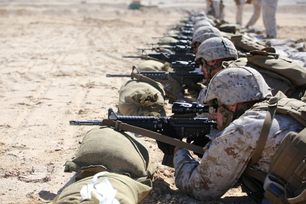 Marines with Company A, Ground Combat Element Integrated Task Force, fire the M4 Modular Weapon System during a zeroing exercise at Range 106, Marine Corps Air Ground Combat Center Twentynine Palms, California, Feb. 24, 2015. From October 2014 to July 2015, the GCEITF will conduct individual and collective level skills training in designated ground combat arms occupational specialties in order to facilitate the standards-based assessment of the physical performance of Marines in a simulated operating environment performing specific ground combat arms tasks. (U.S. Marine Corps photo by Sgt. Alicia R. Leaders/Released)