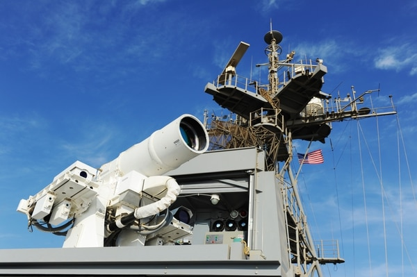 The Afloat Forward Staging Base (Interim) Ponce conducts an operational demonstration of the Laser Weapon System (LaWS) while sailing the Persian Gulf in 2014. (Navy)