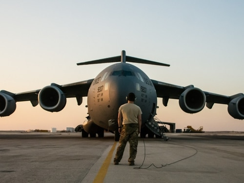 A C-17 Globemaster III prepares for departure Aug. 18 at an undisclosed location in Southwest Asia after transporting cargo between U.S. Africa Command and U.S. Central Command. By the end of September, Al Udeid-based aircraft had completed nearly 15 missions between the two commands. (Tech. Sgt. Ted Nichols/Air Force)
