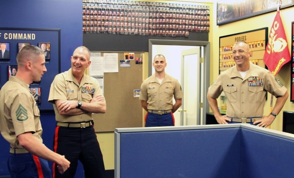 U.S. Marine Corps Maj. Gen. Mark A. Brilakis (2nd from left), Commanding General of Marine Corps Recruiting Command, meets and greets, the staff noncommissioned officer in charge of Recruiting Sub-Station Frederick, Md., U.S. Marine Corps Staff Sgt. Kyle Thomas (far left), U.S. Marine Corps Sgt. William Campbell (second from right) and Recruiting Station Frederick Sgt. Maj., Sgt.Maj. William Sweeney at Recruiting Sub-Station Frederick Sep. 4, 2013 in Frederick, Md. Thomas and Brilakis discussed the intricacies of recruiting duty during the visit, which was Brilakis' initial tour around the area of operations as the new MCRC commanding general.