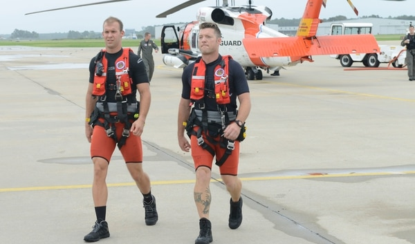 Coast Guard rescue swimmers from Air Station Elizabeth City, North Carolina, preparing to launch for a search and rescue mission on Friday. (3rd Class Ronald Hodges/Coast Guard)