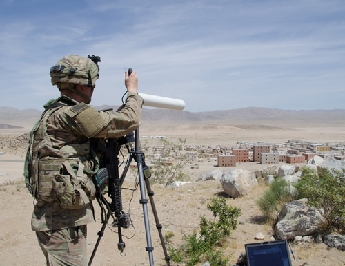 Pfc. Nathaniel Ortiz of the 780th Military Intelligence Brigade sets up cyber tools overlooking the mock city of Razish at the National Training Center at Fort Irwin, Calif., May 5, 2017. (Photo by Bill Roche)