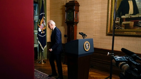 President Joe Biden walks from the podium after speaking from the Treaty Room in the White House on April 14 about the withdrawal all U.S. troops from Afghanistan. (Andrew Harnik/AP)
