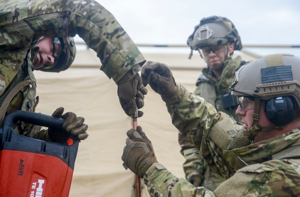 Airmen install a grounding point for the electricity during Contested Forge. (Staff Sgt. Timothy Moore/Air Force)