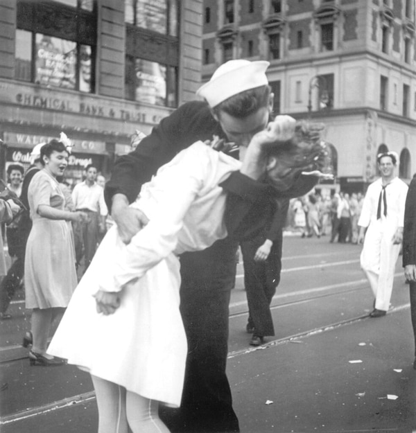 In this Aug. 14, 1945 photo provided by the U.S. Navy, a sailor and a woman kiss in New York's Times Square, as people celebrate the end of World War II. The ecstatic sailor shown kissing a woman in Times Square celebrating the end of World War II has died. George Mendonsa was 95. It was years after the photo was taken that Mendonsa and Greta Zimmer Friedman, a dental assistant in a nurse's uniform, were confirmed to be the couple. (Victor Jorgensen/Navy)