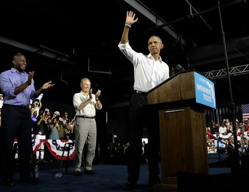 Former President Barack Obama, right, waves during a campaign rally with Democratic gubernatorial candidate Andrew Gillum, left, and U.S. Sen. Bill Nelson, D-Fla., center, on Nov. 2, 2018. (Lynne Sladky/AP)