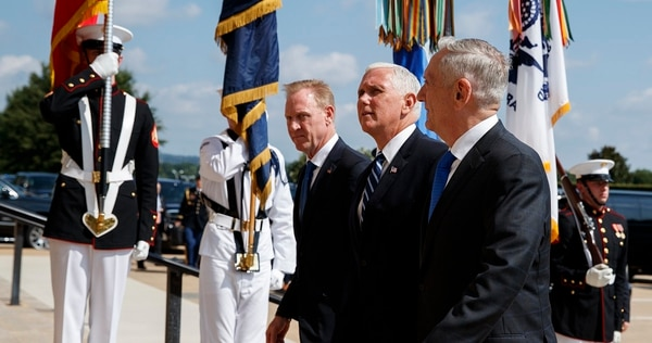 Vice President Mike Pence, center, is greeted by Deputy Secretary of Defense Pat Shanahan, left, and Secretary of Defense Jim Mattis before speaking at a Pentagon event on the creation of a United States Space Force. (Evan Vucci/AP)