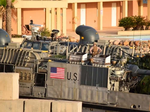 A U.S. amphibious hovercraft prepares to depart with evacuees from Janzur, west of Tripoli, Libya, April 7. The United States says it has temporarily withdrawn some of its forces from Libya due to deteriorating security conditions. (Mohammed Omar Aburas/AP)