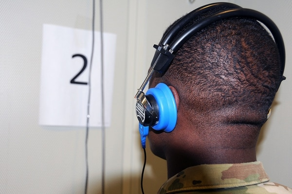 Spc. David Dunbar listens for audio tones during a hearing test. The Army secretary is open to admitting recruits with less-than-perfect hearing if they are otherwise stellar candidates. (Army)