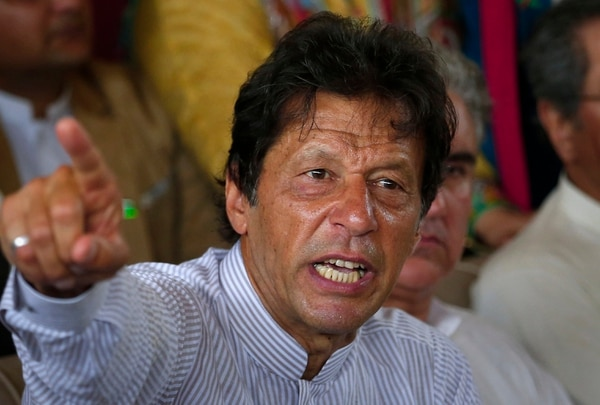Pakistani opposition leader Imran Khan gestures during a news conference regarding the dismissal of Pakistani Prime Minister Nawaz Sharif, in Islamabad, Pakistan, on July 28, 2017. Opposition lawmakers, who petitioned the court for disqualification of Sharif, welcomed the court decision, saying it was a victory for justice. (Anjum Naveed/AP)