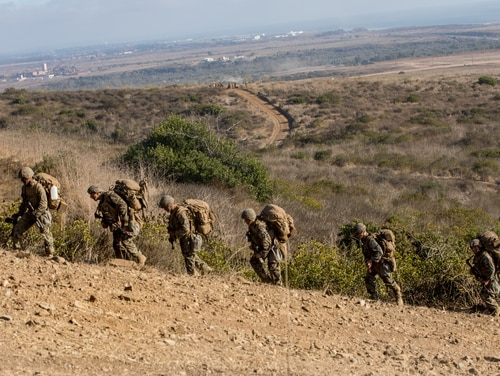 Marines with Charlie Company, 1st Battalion, 5th Marine Regiment, 1st Marine Division, hike up a hill during the Marine Corps Combat Readiness Evaluation on Marine Corps Base Camp Pendleton, California, Sept. 23. (Lance Cpl. Alexa M. Hernandez/Marine Corps)