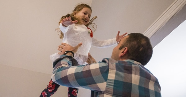 Eric Andonian tosses his daughter Eliza in the air in their home on Wednesday, Feb. 14, 2018 in Franklin, Tenn. Andonian, a corporal in the New York Army Reserve, came back home to Franklin earlier this month from a 12-month deployment in Afghanistan. During his tour, his family moved from New York City to Tennessee to be closer. (Erica Brechtelsbauer/The Tennessean via AP)