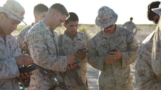 Marines with Fox Company, 2nd Battalion, 7th Marine Regiment use tablets to help them in a training exercise at Marine Corps Air Station Yuma, Ariz., Oct. 14, 2015. The tablets are wirelessly connected through an encrypted internal Wi-Fi network allowing Marines to coordinate and maneuver more efficiently in a tactical environment while securely using various applications on the devices. (Lance Cpl. David Staten/Marine Corps)