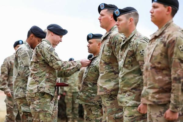 Col. Dave Zinn, 2nd Infantry Brigade Combat Team, 4th Infantry Division commander, pins an Army Commendation Medal with a V device on Sgt. 1st Class Timoeto Salinas, April 12, 2019, during an awards ceremony on Fort Carson, Colorado. (Staff Sgt. Neysa Canfield/Army)