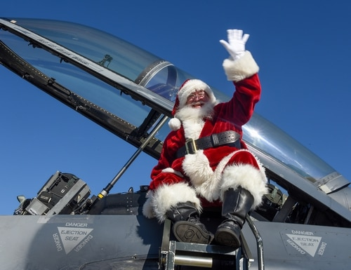 Santa Claus waves as he arrives in a 169th Fighter Wing F-16 Fighting Falcon at McEntire Joint National Guard Base, S.C., Dec. 7, 2019. (Staff Sgt. Megan Floyd/Air National Guard)