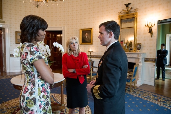First Lady Michelle Obama and Dr. Jill Biden talk with Capt. Todd Veazie, Executive Director of Joining Forces, on his last day, in the Blue Room following a Joining Forces initiative employment announcement for veterans and military spouses, April 30, 2013. (Official White House Photo by Chuck Kennedy) This official White House photograph is being made available only for publication by news organizations and/or for personal use printing by the subject(s) of the photograph. The photograph may not be manipulated in any way and may not be used in commercial or political materials, advertisements, emails, products, promotions that in any way suggests approval or endorsement of the President, the First Family, or the White House.