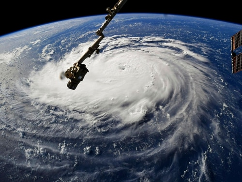 Hurricane Florence sprawls below the International Space Station on Monday, as the storm threatens the U.S. East Coast. Forecasters said Florence could become an extremely dangerous major hurricane sometime Monday and remain that way for days. (NASA via AP)