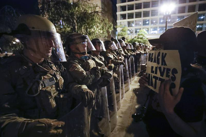 Utah National Guard soldiers line the street as demonstrators gather to protest the death of George Floyd, Wednesday, June 3, 2020, near the White House in Washington.