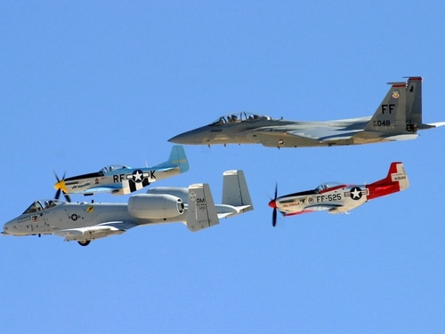 Two P-51 Mustangs, an A-10 Thunderbolt II and an F-15D Eagle team up during an air show at Nellis Air Force Base, Nev. This year's Super Bowl flyover will feature a P-51, two A-10s and an F-16. (Julie Ray/Air Force)