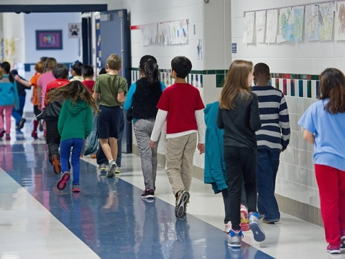 Students walking the hallways are seen February 21, 2014, at Steuart W. Weller Elementary School in Ashburn, Virginia AFP PHOTO/Paul J. Richards (Photo credit should read PAUL J. RICHARDS/AFP/Getty Images)