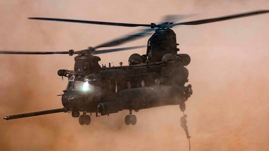 U.S. Army soldiers assigned to 19th Special Forces Group (Airborne), and Royal Moroccan Army soldiers fast-rope out of a CH-47 Chinook in Tifnit, Morocco, on June 14, 2021, during . African Lion 2021. (Spc. Brendan Nunez/Army)